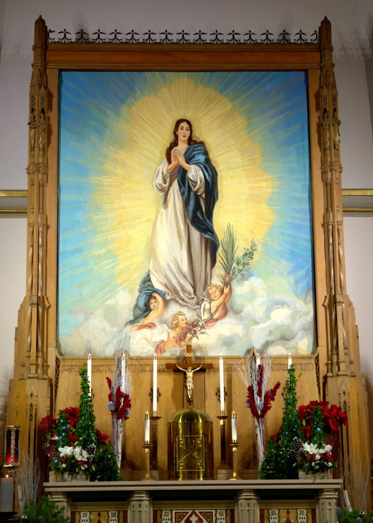 Current Mary Tapestry over the altar