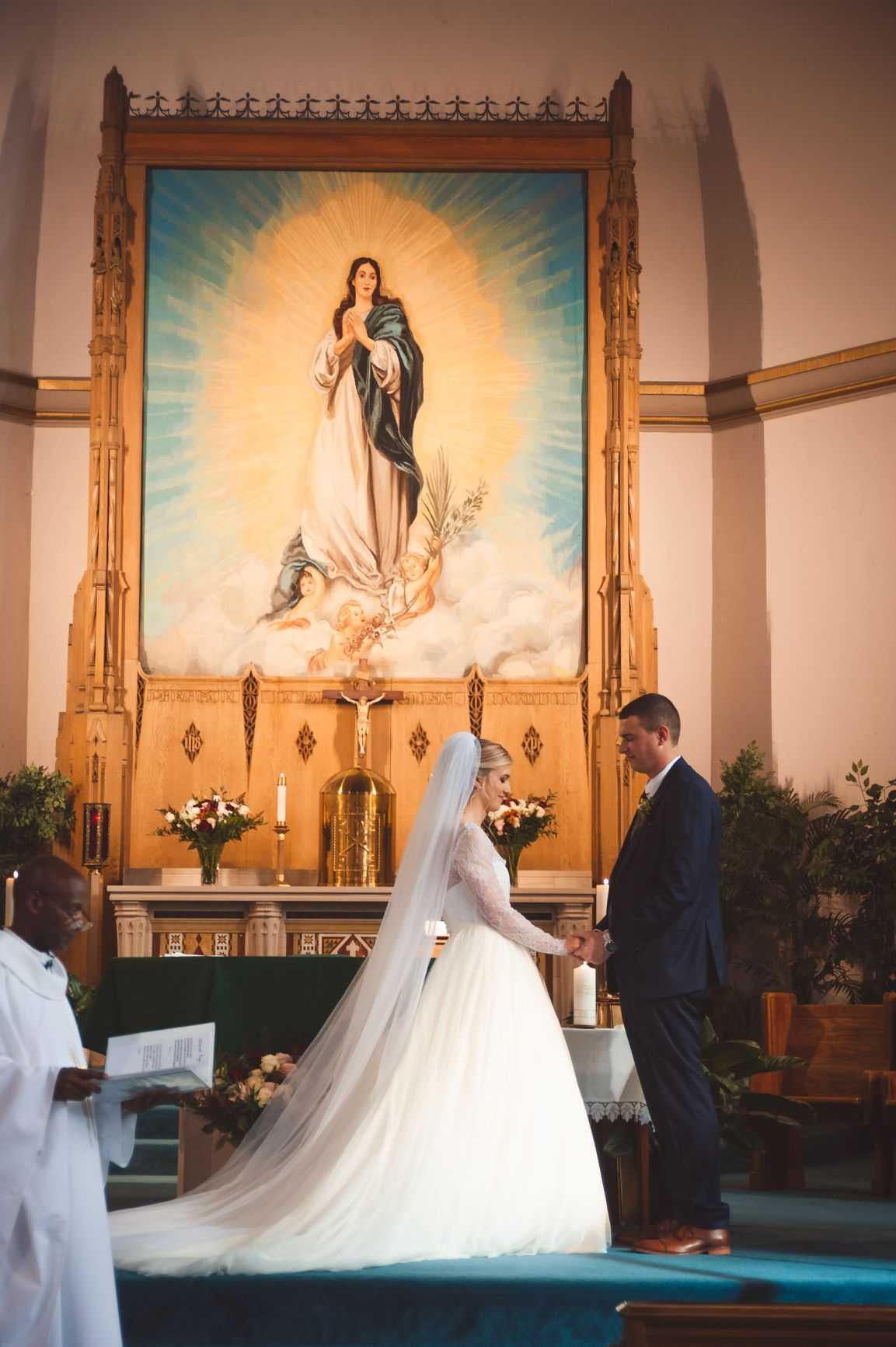 A photo of the wedding of Allie (Robinson) & Allan Runions, November 2019 standing in front of the altar