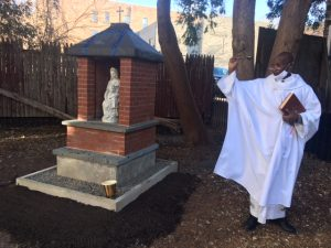 Father Chumo blesses the outdoor Mary Shrine